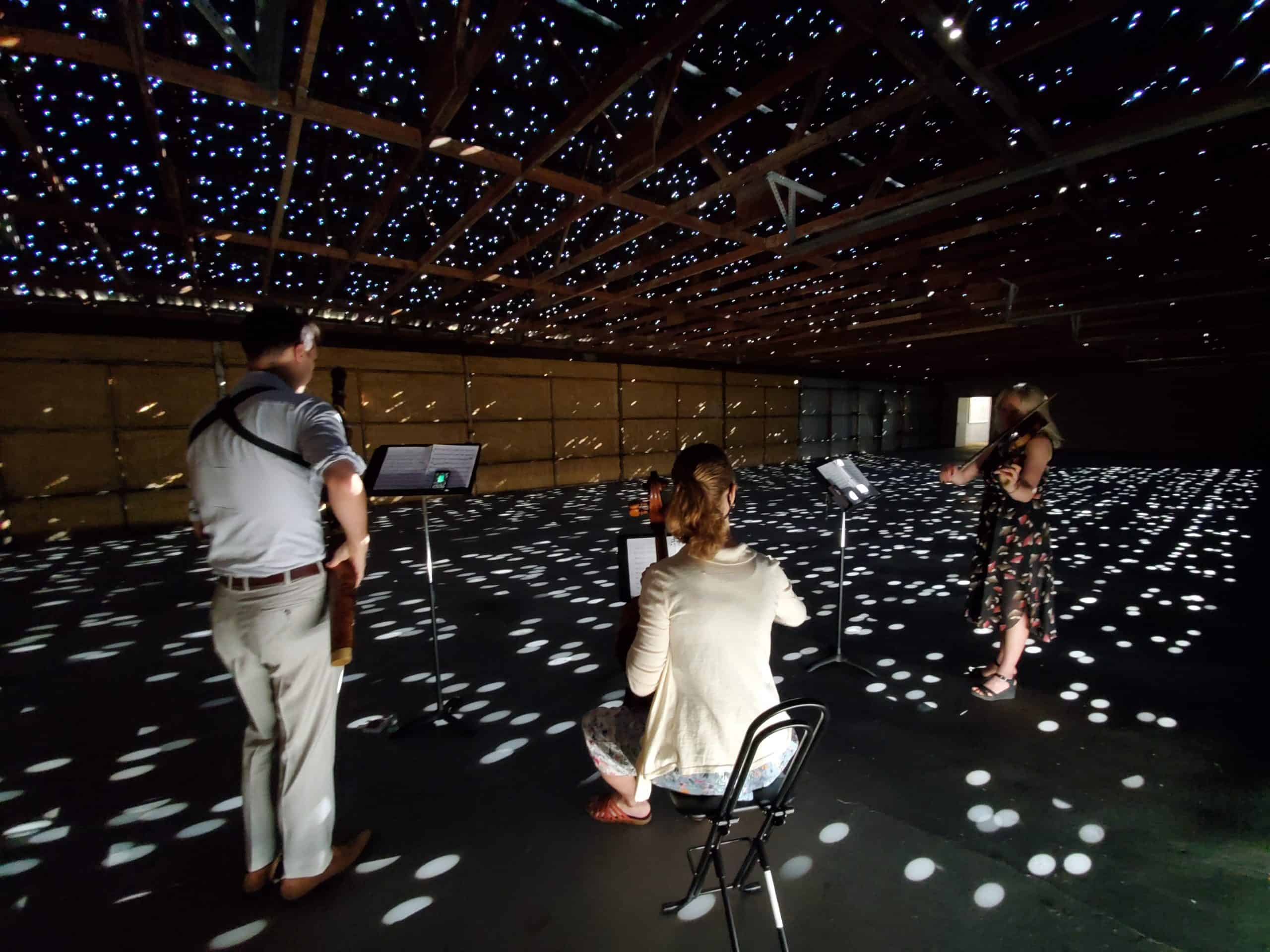 Nate, Carrie, and Annabeth rehearse in a space created by Chris Fraser called Asterisms